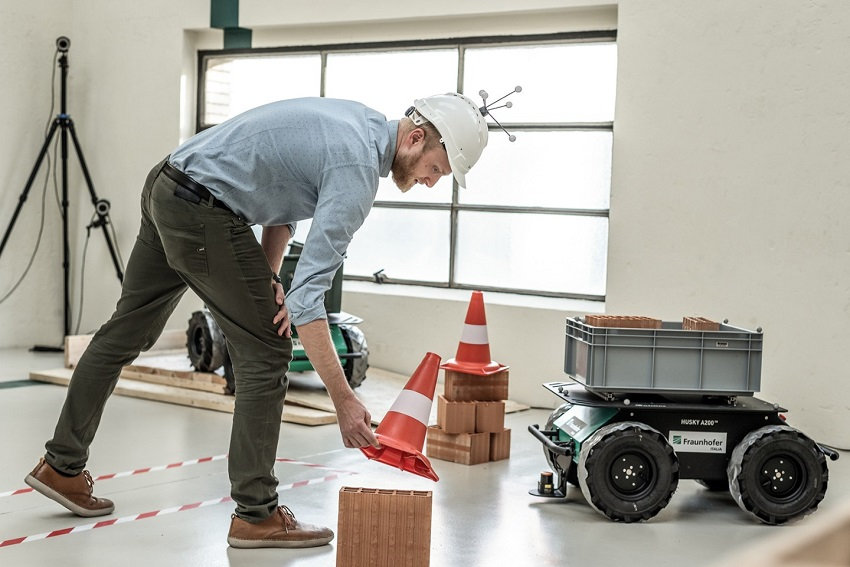 Researcher at the Fraunhofer Italia Innovation Engineering Center with the Husky mobile robotic platform