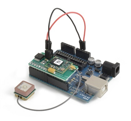 GPS Shield connected on an Arduino board with a GPS antenna