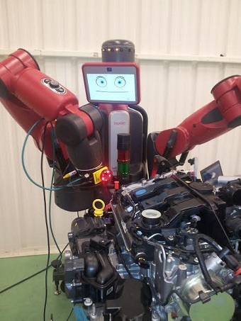 baxter robot with a Cognex In-Sight camera mounted on its arm